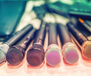 collection of microphones and dj equipement at a concert