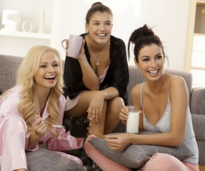 Girls watching tv at home